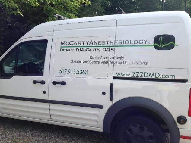 White van with logo for Dr. Patrick McCarty Board Certified Dentist Anesthesiologist on side