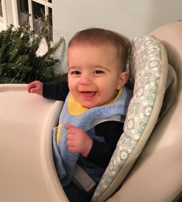 Baby smiling in high chair | Dentist Duxbury MA