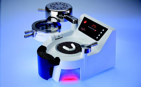 an image of a mouth guard/retainer making machine | duxbury MA dentist