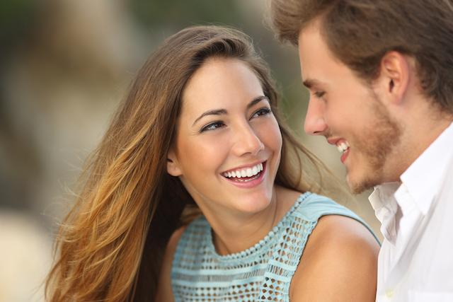 Woman smiling at man | Dentist Duxbury MA