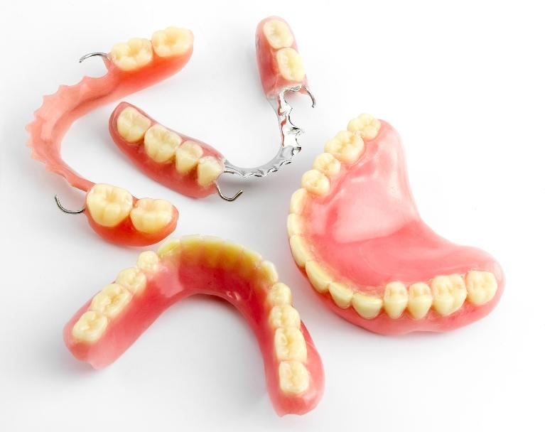 dentures sit on a white background | dentures duxbury ma